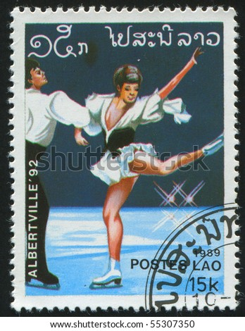 LAOS - CIRCA 1989: stamp printed by Laos, shows professional figure skaters, circa 1989. - stock photo