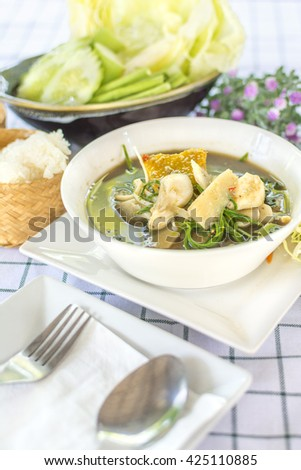 Laos curry  (Thai call Kaeng Nor Mai Sai Biyanang or Kaeng Lao or Tom Prer) baby bamboo pumpkin and mixed vegetable Shoot Soup the traditional delicious Northeastern Style Thai food.