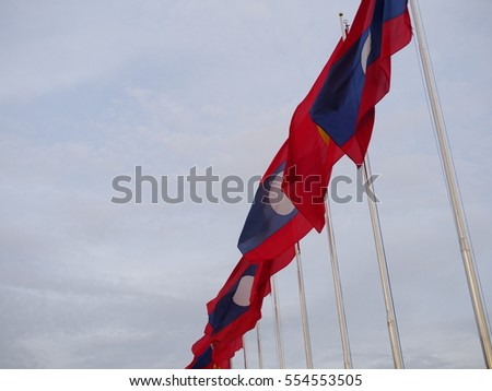 Laos flags with cloudy sky