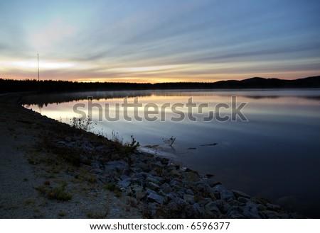 lapland sunset on a calm autumn's night - stock photo