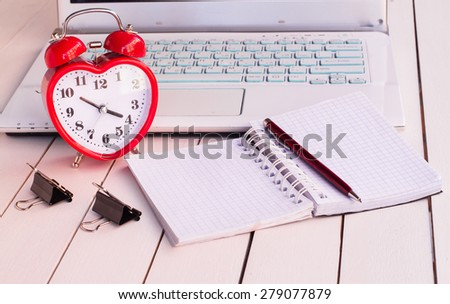 laptop and alarm clock - stock photo