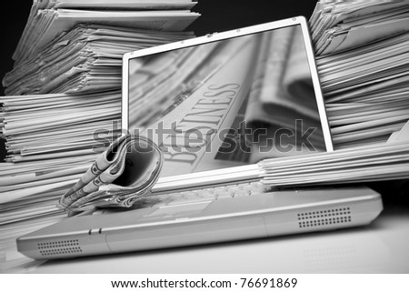 Laptop and Business newspaper - stock photo