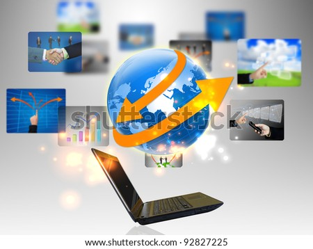 laptop and business world - stock photo