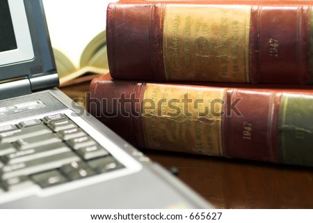 Laptop and Legal books on table - South African Law Reports - Shallow DOF