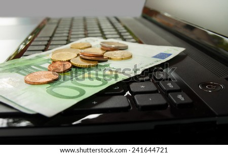 Laptop and money - stock photo