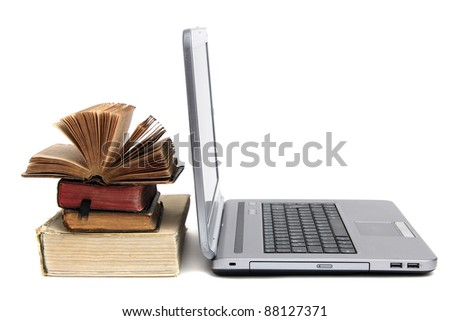 laptop and old book