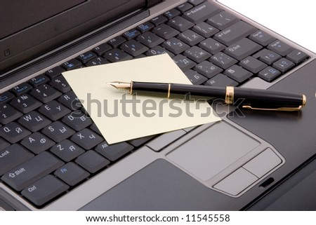laptop and pen - stock photo