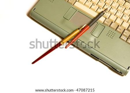Laptop and pen on white backgrounds - stock photo
