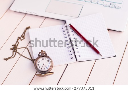 laptop and pocket watches - stock photo
