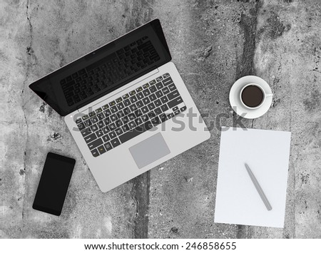 Laptop and smartphone on concrete background - stock photo
