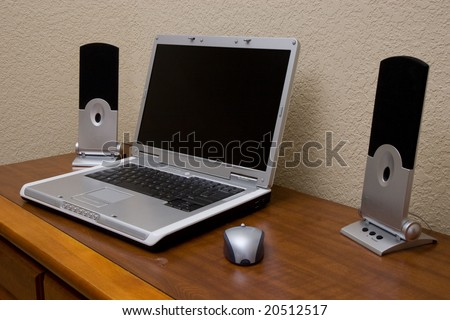laptop and speakers in bedroom - stock photo