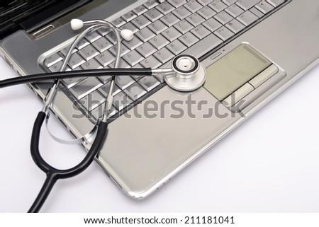 Laptop and stethoscope - stock photo