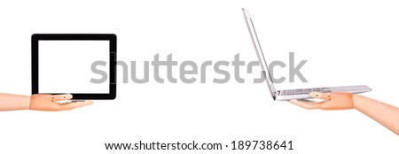 laptop and tablet computers with wooden hands, isolated on white background - stock photo