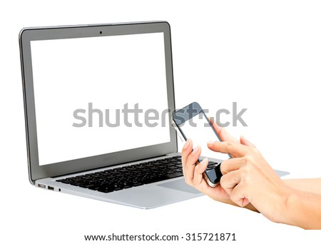 Laptop and woman hand hold and touch screen smart phone on a white background.