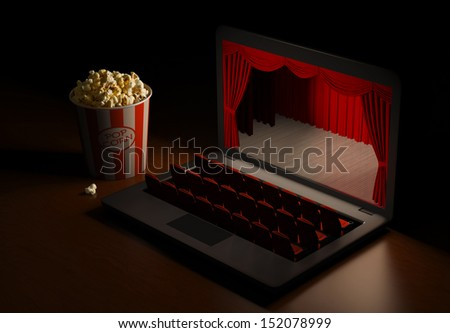 Laptop as an cinema. Home entertainment. View the video by subscription. Home Theater. - stock photo