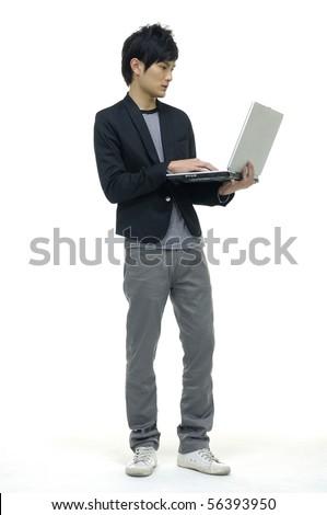 Laptop asian young man - stock photo