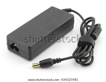 Laptop battery charger adapter - stock photo