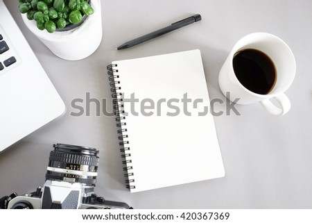 Laptop, blank notebook, pen, with cup of coffee and little plant pot,traveler planer  - stock photo
