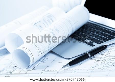 Laptop. Blueprints and laptop - stock photo