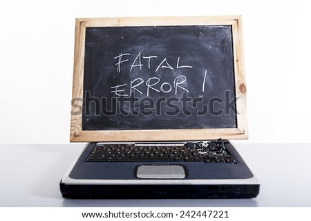 laptop broken with a wooden monitor - stock photo