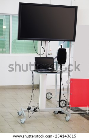 laptop computer and a large monitor on a white background