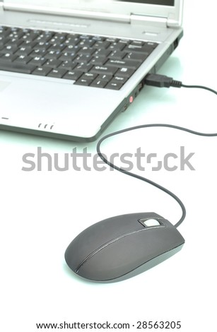 Laptop computer and a mouse against white background