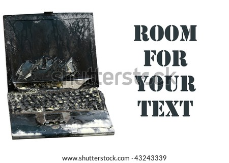 Laptop computer burned in a fire, represents computer damage, loss of data, emergency and more, isolated on white - stock photo