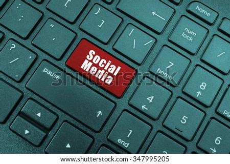 Laptop computer keyboard with social media button - stock photo