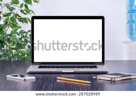 Laptop computer mockup with blank screen on office wooden desk. For design presentation or portfolio. All gadgets in full focus. - stock photo