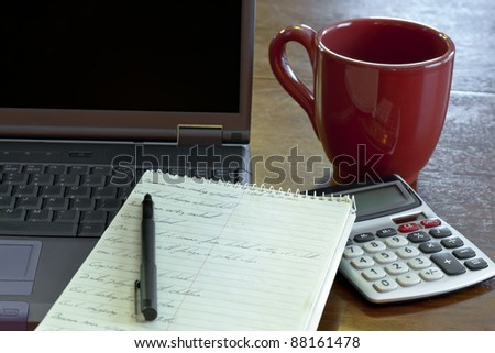 Laptop computer on a desk in a working environment - stock photo