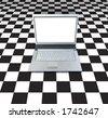 Laptop Computer On Checker Board - stock photo