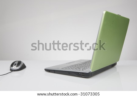 laptop computer on white surface - stock photo