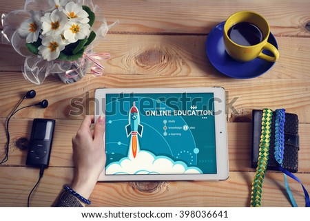Laptop computer, tablet pc and Online education design concept on wooden office desk with copy space. Online education design concept background with rocket.  - stock photo