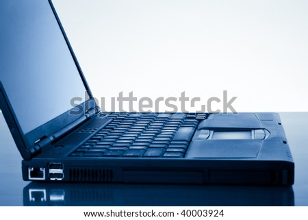laptop computer with copy space - blue toned