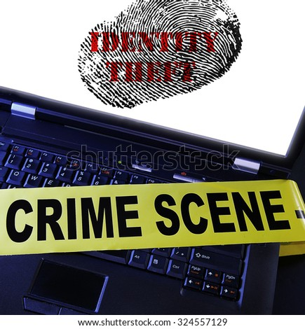 laptop computer with Identity Theft fingerprint and crime scene tape - stock photo