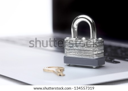 Laptop Computer With Lock and Key Symbolizing Protection and Safety - stock photo