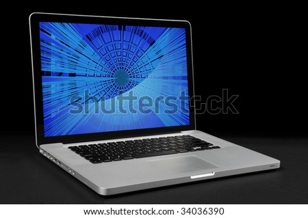 Laptop computer with over dark background - stock photo