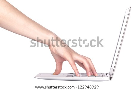 laptop computer with woman hand isolated on a white background - stock photo