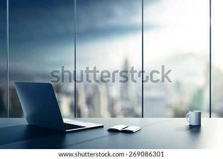 laptop, cup and diary on table in office - stock photo