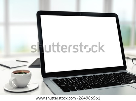 laptop, cup and diary on table in office, shallow depth of field - stock photo