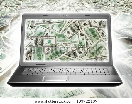 Laptop full of dollars on money background - stock photo