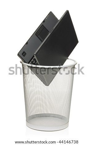 Laptop in a trash bin isolated against white background - stock photo