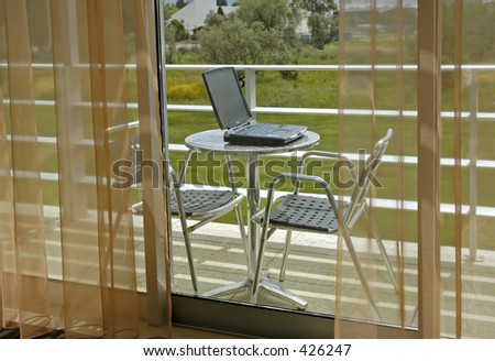 Laptop in Balcony - stock photo