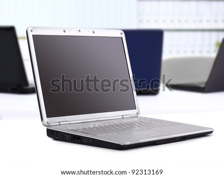 Laptop in the office on the table - stock photo