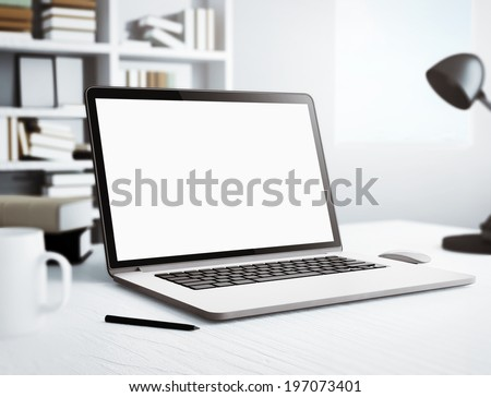 Laptop in white room - stock photo