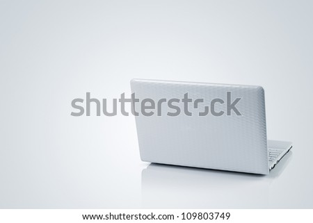 Laptop isolated on gray background with copy space - stock photo
