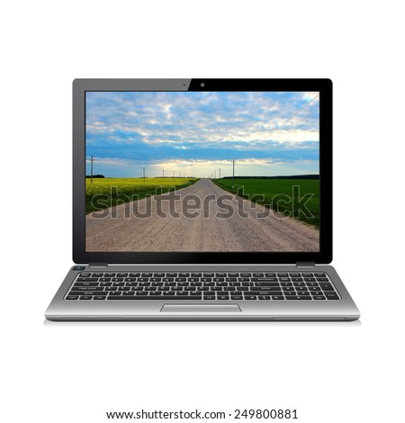 Laptop isolated on white with road on screen - stock photo