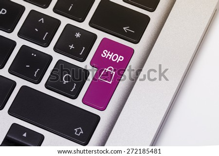 """Laptop key showing the word """"shop"""", in purple color. - stock photo"""