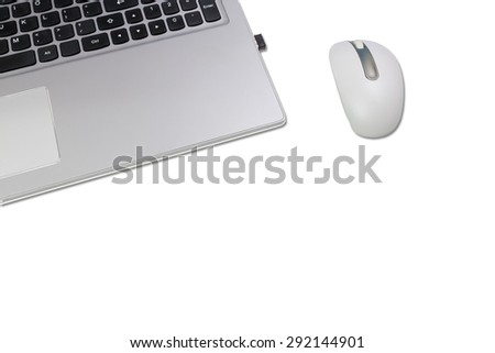laptop keyboard and mouse on white desktop