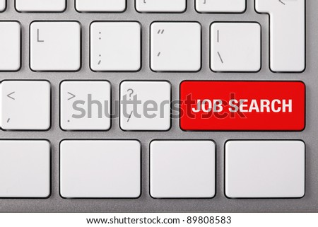 "Laptop keyboard and red key ""JOB SEARCH"" on it. - stock photo"